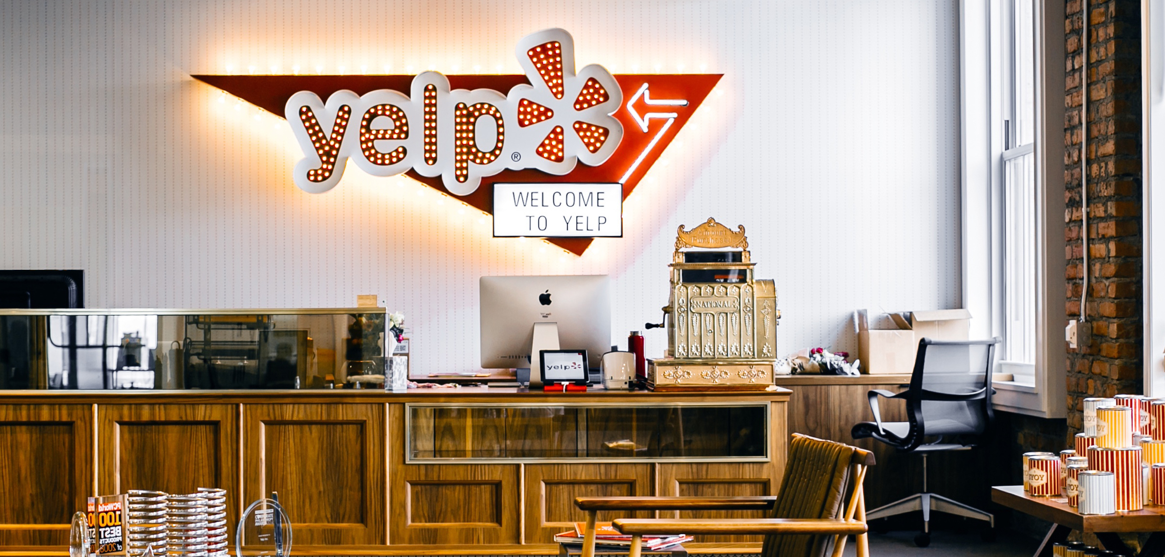 Photo of Yelp HQ with an Envoy Visitors kiosk at the front desk
